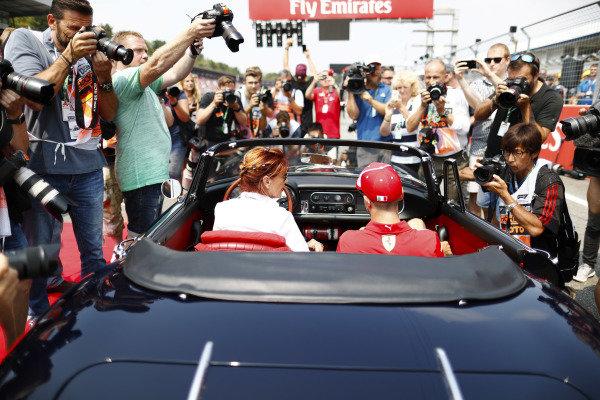 Sebastian Vettel, Ferrari, is photographed in a Ferrari 275 convertible.