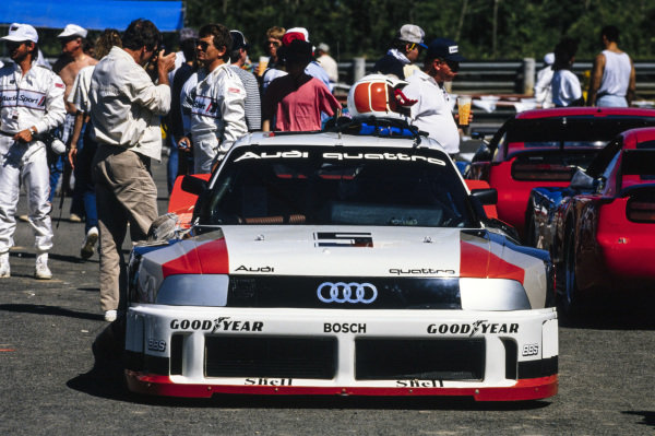 Car of Hurley Haywood, Audi 90 quattro. His helmet rests on top of the car.
