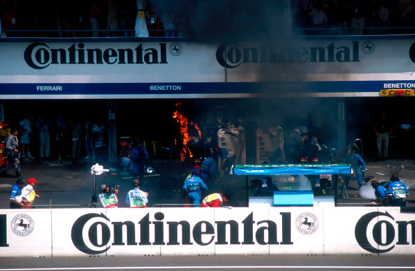 1994 German Grand Prix.Hockenheim, Germany.29-31 July 1994.Jos Verstappen (Benetton B194 Ford) came in for his pitstop. As the Refueller pulled the fuel hose away the valve stuck open allowing fuel to still come out of the nozzle and over the car which ignited into a huge fireball. The fire was delt with quite swiftly though.Ref-94 GER 48.World Copyright - LAT Photographic