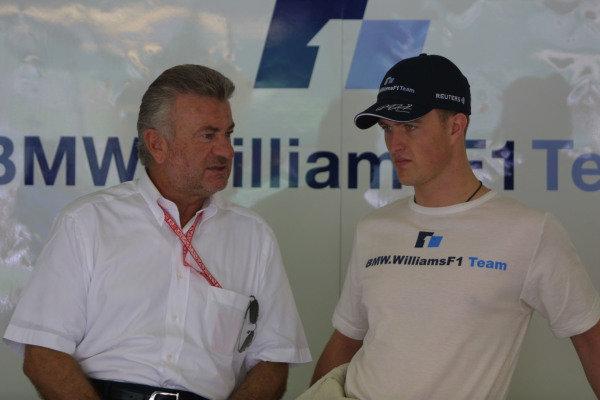 2001 Malaysian Grand Prix.Sepang, Kuala Lumpur, Malaysia.16-18 March 2001.Ralf Schumacher (Williams BMW) with his manager Willi Weber.World Copyright - LAT PhotographicRef-8 9MB Digital