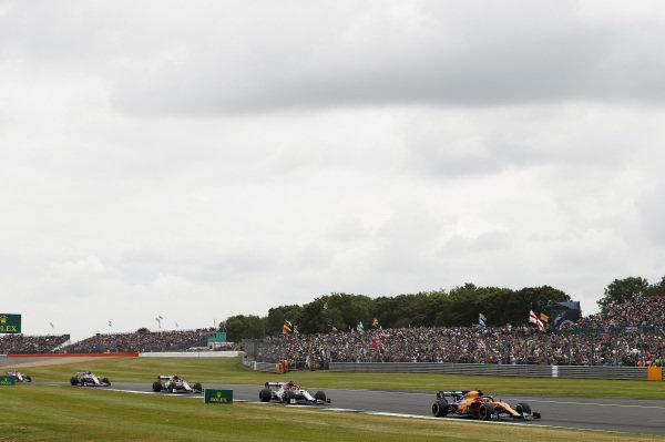 Carlos Sainz Jr., McLaren MCL34, leads Kimi Raikkonen, Alfa Romeo Racing C38, and Antonio Giovinazzi, Alfa Romeo Racing C38, on the formation lap