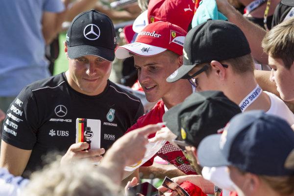 Valtteri Bottas (FIN) Mercedes AMG F1 fans selfie at Formula One World Championship, Rd9, Austrian Grand Prix, Qualifying, Spielberg, Austria, Saturday 8 July 2017.