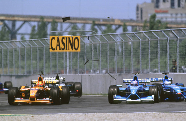 2001 Canadian Grand PrixMontreal, Canada. 8th-10th June 2001Debris flies as the Benetton Renault B201's of Jenson Button and Giancarlo Fisichella, collide on the opening lap.World Copyright: LAT Photographicref: 35mm Image A04