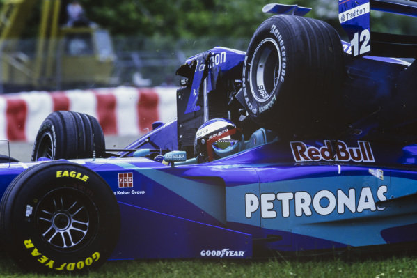 The car of Jarno Trulli, Prost AP01 Peugeot, ends up on top of Jean Alesi, Sauber C17 Petronas, after a collision.
