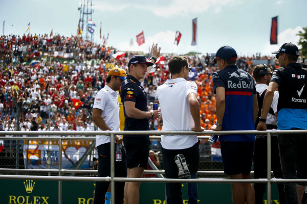 Carlos Sainz Jr, McLaren, Max Verstappen, Red Bull Racing, Lando Norris, McLaren, and Alexander Albon, Toro Rosso, in the drivers parade
