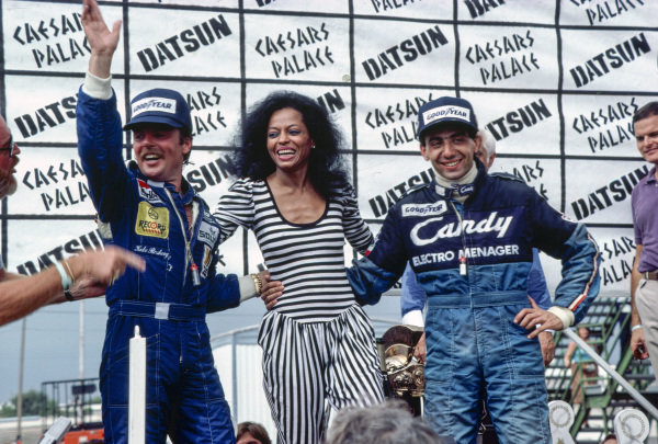 Newly-crowned world champion Keke Rosberg, Diana Ross and Michele Alboreto, 1st position, on the podium.