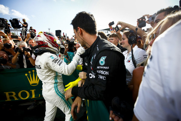 Race winner Lewis Hamilton, Mercedes AMG F1 celebrates in Parc Ferme with his team