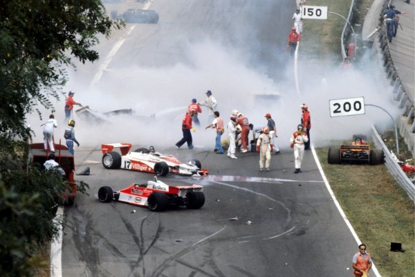The immediate aftermath of the multi-car accident at the start of the race: Ronnie Peterson (SWE) Lotus (Yellow overalls) lies in the track having been pulled from his shattered, burning, Lotus 78, and is tended to by marshals, Clay Regazzoni (SUI) Shadow (Red Overalls) and Patrick Depailler (FRA) Tyrrell (Blue helmet). James Hunt (GBR) McLaren (Black helmet) walks from the scene with team mate Bruno Giacomelli (ITA) McLaren. Vittorio Brambilla (ITA) (Right) lies - head slumped -in his Surtees TS20 after suffering a serious head injury from which he fully recovered. Tragically, Peterson would die from a blood clot following an operation in hospital on his badly broken legs. Italian Grand Prix, Rd 14, Monza, Italy, 10 September 1978. BEST IMAGE