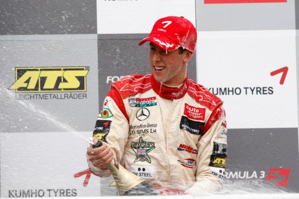 Brands Hatch, England.6th September 2009.Alexander Sims (GBR, Mucke Motorsport) 2nd sprays champagne on the podium.World Copyright: Andrew Ferraro/LAT Photographicref: Digital Image_H0Y4428 jpg