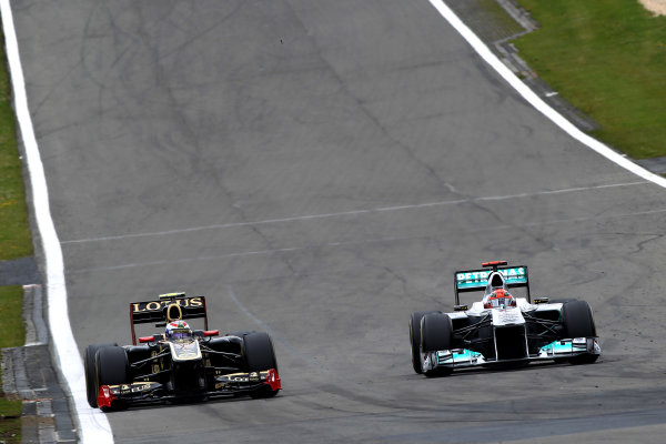 Nurburgring, Germany.24th July 2011Michael Schumacher, Mercedes GP W02, 8th position, passes Vitaly Petrov, Lotus Renault GP R31, 10th position. Action. World Copyright: Andy Hone/LAT Photographicref: Digital Image CSP13165