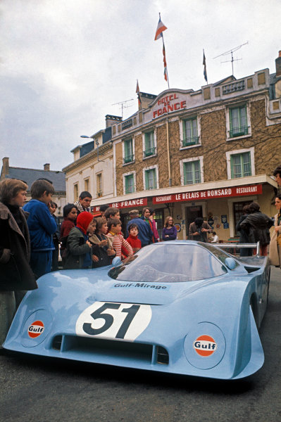 Le Mans, France. 1st position, April June 1973 Derek Bell (Mirage M6 Ford-Weslake), 3rd position, during scruntineering in the town centre, atmosphere World Copyright: LAT PhotographicRef: 73LM32.