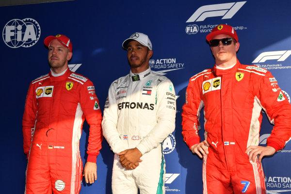 (L to R): Sebastian Vettel (GER) Ferrari, pole sitter Lewis Hamilton (GBR) Mercedes-AMG F1 and Kimi Raikkonen (FIN) Ferrari in parc ferme