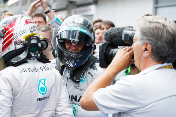 Red Bull Ring, Spielberg, Austria. Sunday 22 June 2014. Nico Rosberg, Mercedes AMG, 1st Position, and Lewis Hamilton, Mercedes AMG, 2nd Position, celebrate in Parc Ferme. World Copyright: Charles Coates/LAT Photographic. ref: Digital Image _N7T4997