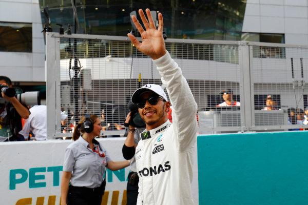 Sepang International Circuit, Sepang, Malaysia. Saturday 30 September 2017. Pole winner Lewis Hamilton, Mercedes AMG, waves to fans. World Copyright: Steven Tee/LAT Images  ref: Digital Image _O3I3517