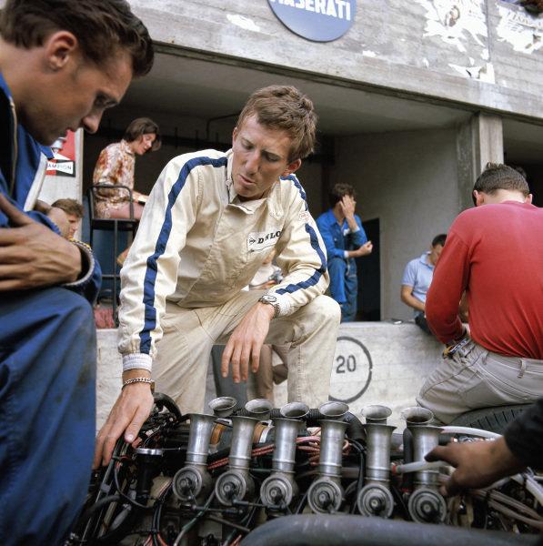 Jochen Rindt beside the Maserati V12 engine of his Cooper  T86.