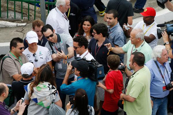 Interlagos, Sao Paulo, Brazil. Sunday 9 November 2014. Nico Rosberg, Mercedes AMG, poses for photos with fans. World Copyright: Charles Coates/LAT Photographic. ref: Digital Image _J5R5217