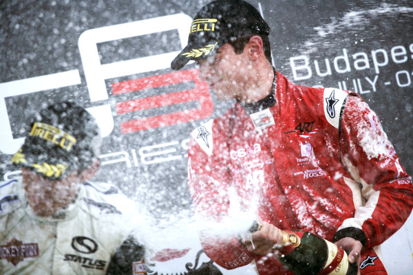 Round 6.Hungaroring, Budapest, Hungary. 1st August 2010. Sunday Race.Alexander Rossi (USA, ART Grand Prix) celebrates victory on the podium with Robert Wickens, (CAN, Status Grand Prix).Portrait. World Copyright: Drew Gibson/GP3 Media Service. Digital Image _Y8P5020