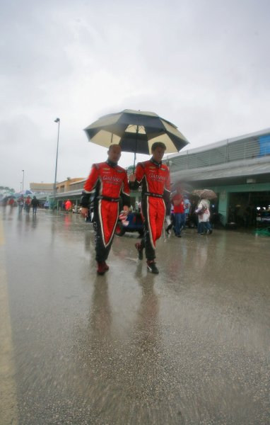 27-29 March, 2012, Homestead, Florida USA Jon Fogarty and Alex Gurney walk to the driver's meeting in the rain. (c)2012, R.D. Ethan LAT Photo USA
