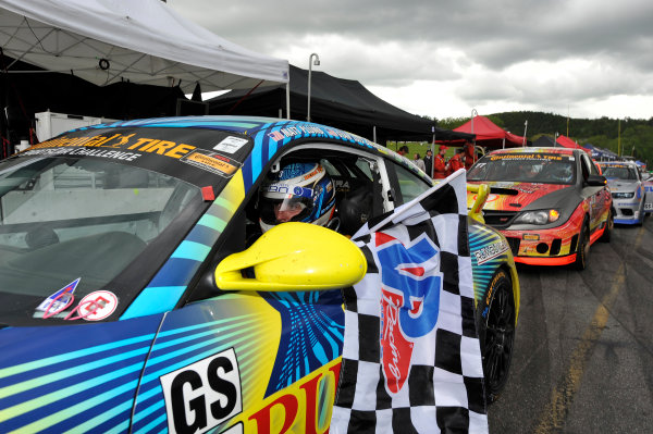 23-24 May, 2014, Lakeville, Connecticut USA 13, Porsche, 997, GS, Matt Plumb, celebrates the win with checkered flag ©2014 Scott R LePage  LAT Photo USA
