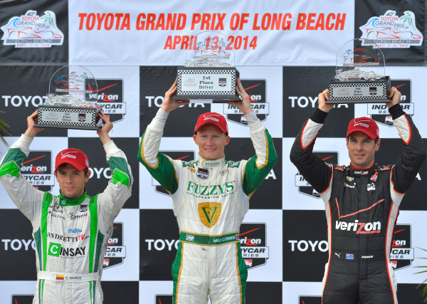 "11-13 April, 2014, Long Beach, California USA #20 Mike Conway Fuzzy""s Vodka/ Ed Carpenter Racing, race winner on podium with Will Power and Carlos Munoz ©2014, Dan R. Boyd Lat Photo USA"