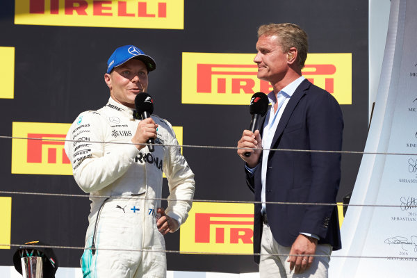 Hungaroring, Budapest, Hungary.  Sunday 30 July 2017. Valtteri Bottas, Mercedes AMG, 3rd Position, is interviewed on the podium by David Coulthard, Channel 4 F1. World Copyright: Steve Etherington/LAT Images  ref: Digital Image SNE14650