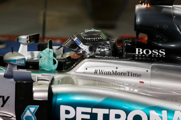 Yas Marina Circuit, Abu Dhabi, United Arab Emirates. Sunday 29 November 2015. Nico Rosberg, Mercedes AMG, 1st Position, celebrates on arrival in Parc Ferme. World Copyright: Charles Coates/LAT Photographic ref: Digital Image _99O2597