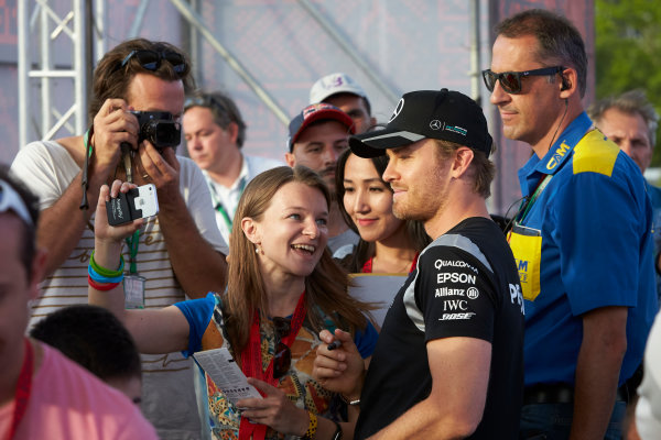 Baku City Circuit, Baku, Azerbaijan. Thursday 16 June 2016. Nico Rosberg, Mercedes AMG, poses for a photo with a fan. World Copyright: Steve Etherington/LAT Photographic ref: Digital Image SNE20728