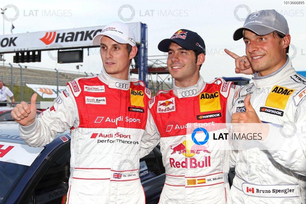 Top three qualifiers: Miguel Molina (ESP), Audi Sport Team Abt Junior, Red Bull Audi A4 DTM (2008) (pole position), centre; Bruno Spengler (CDN), Mercedes-Benz Bank AMG C-Klasse (2009) (2nd), right; Oliver Jarvis (GBR), Audi Sport Team Abt, Audi Performance A4 DTM (2009) (3rd), left.DTM, Rd8, Oschersleben, Germany, 16-18 September 2011 Ref: Digital Image dne1117se500