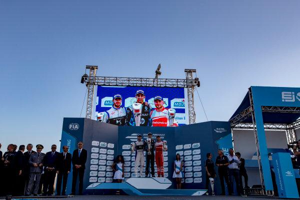 2016/2017 FIA Formula E Championship. Marrakesh ePrix, Circuit International Automobile Moulay El Hassan, Marrakesh, Morocco. Saturday 12 November 2016. Sam Bird (GBR), DS Virgin Racing, Spark-Citroen, Virgin DSV-02, Sebastien Buemi (SUI), Renault e.Dams, Spark-Renault, Renault Z.E 16 and Felix Rosenqvist (SWE), Mahindra Racing, Spark-Mahindra, Mahindra M3ELECTRO on the podium. Photo: Zak Mauger/Jaguar Racing ref: Digital Image _X0W6655