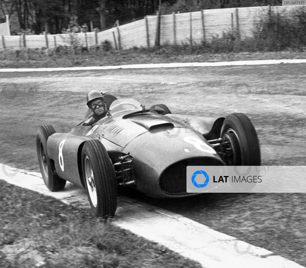 1956 Belgian Grand Prix. Spa-Francorchamps, Belgium. 3 June 1956. Peter Collins (Lancia-Ferrari D50), 1st position. World Copyright - LAT Photographic Ref: 801.