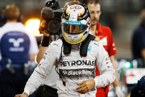 Yas Marina Circuit, Abu Dhabi, United Arab Emirates. Saturday 22 November 2014. Lewis Hamilton, Mercedes AMG, arrives in Parc Ferme after Qualifying. World Copyright: Steven Tee/LAT Photographic. ref: Digital Image _X0W0071