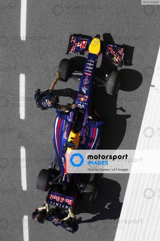 Circuit de Catalunya, Barcelona, Spain. Friday 9 May 2014. The car of Sebastian Vettel, Red Bull Racing RB10 Renault, is returned to the garage. World Copyright: Charles Coates/LAT Photographic. ref: Digital Image _J5R9035