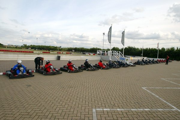 The competitors line up in the pits before the start of qualifying.  