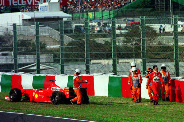 Japanese Grand Prix.Suzuka, Japan.30/10-1/11 1998.Michael Schumacher (Ferrari F300) retires from the race.World Copyright - Photo 4/LAT Photographic