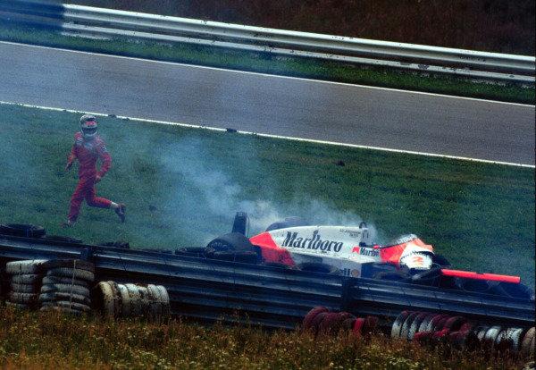 1987 Austrian Grand Prix.Osterreichring, Zeltweg, Austria.14-16 August 1987.Stefan Johansson (McLaren MP4/3 TAG Porsche) runs away from the wreckage after crashing.World Copyright - LAT Photographic