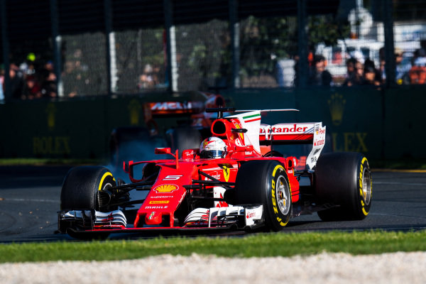 Sebastian Vettel (GER) Ferrari SF70-H locks up at Formula One World Championship, Rd1, Australian Grand Prix, Race, Albert Park, Melbourne, Australia, Sunday 26 March 2017.