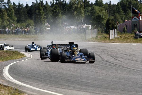 Ronnie Peterson, Lotus 72E Ford leads Emerson Fittipaldi, Lotus 72E Ford.