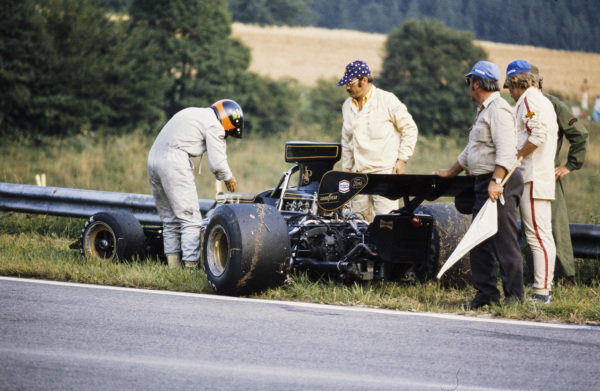 Emerson Fittipaldi retires his Lotus 72E Ford on the side of the track.