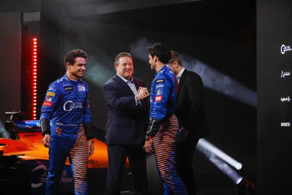 Lando Norris, McLaren, and Carlos Sainz Jr, McLaren, are greeted by Zak Brown, CEO, McLaren Racing, and Andreas Seidl, Team Principal, McLaren