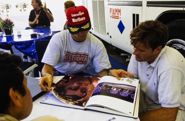 Christian Fittipaldi looks through a book of Ayrton Senna photography.