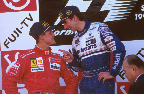 Suzuka, Japan.11-13 October 1996.Damon Hill (Williams Renault) 1st position, makes a point of telling Michael Schumacher (Ferrari) 2nd position that he is the new World Champion.Ref-96 JAP 09.World Copyright - LAT Photographic