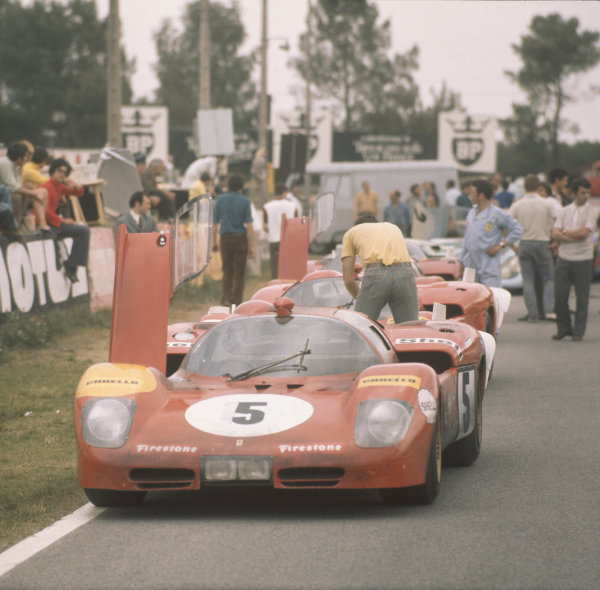A Ferrari 512S is parked at Mulsanne Corner with its door open during filming of the Steve McQueen movie Le Mans. In the real race, the car was driven by Jacky Ickx and Peter Schetty