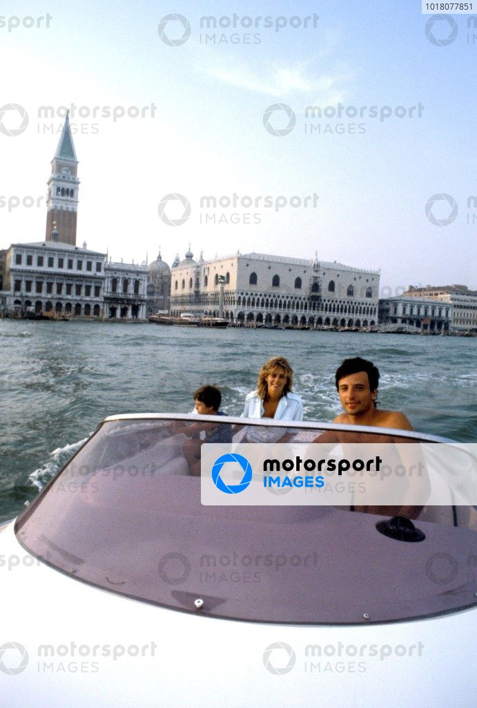 Venice 1983. Riccardo Patrese in a boat on the canals with his wife Susi and son Simone