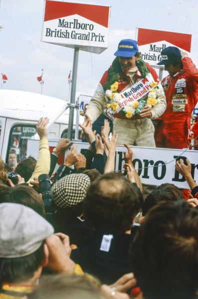 John Watson, 1st position, celebrates with fans.