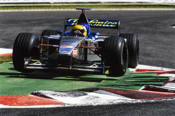 Luca Badoer, Minardi M01 Ford, runs over a kerb.