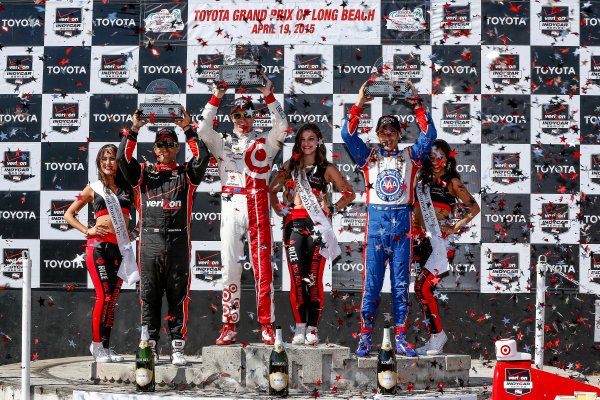17-19 April, 2015, Long Beach, California USA Juan Pablo Montoya, Scott Dixon and Helio Castroneves on the podium ©2015, Michael L. Levitt LAT Photo USA
