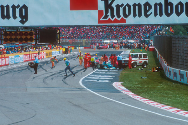 Imola, Italy.29/4-1/5 1994.Marshalls and track officials clear up after the Lehto/Lamy startline shunt.Ref-94 SM 13.World Copyright - LAT Photographic