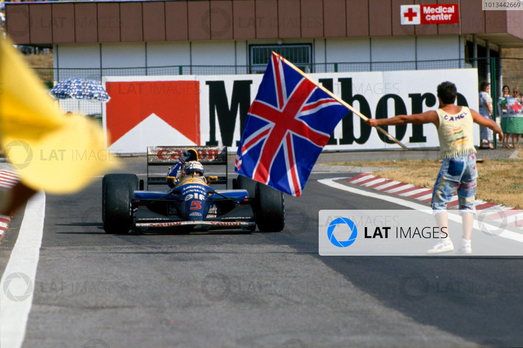 Hungaroring, Budapest, Hungary.14-16 August 1992.Nigel Mansell (Williams FW14B Renault) 2nd position, celebrates winning the drivers World Championship. World Copyright - LAT Photographic
