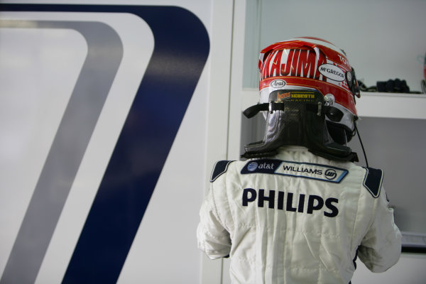 Sepang, Kuala Lumpur, Malaysia 3rd April 2009 Kazuki Nakajima, Williams FW31 Toyota. Fastens his helmet. Portrait.  World Copyright: Glenn Dunbar/LAT Photographic ref: Digital Image YY8P0686