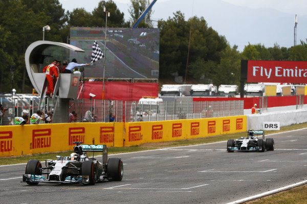 Circuit de Catalunya, Barcelona, Spain. Sunday 11 May 2014. Lewis Hamilton, Mercedes F1 W05 Hybrid, 1st Position, and Nico Rosberg, Mercedes F1 W05 Hybrid, 2nd Position, take the chequered flag. World Copyright: Andy Hone/LAT Photographic. ref: Digital Image _ONZ1790